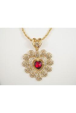 Collier et médaillon en forme de coeur orné de pierres bijoux orientaux