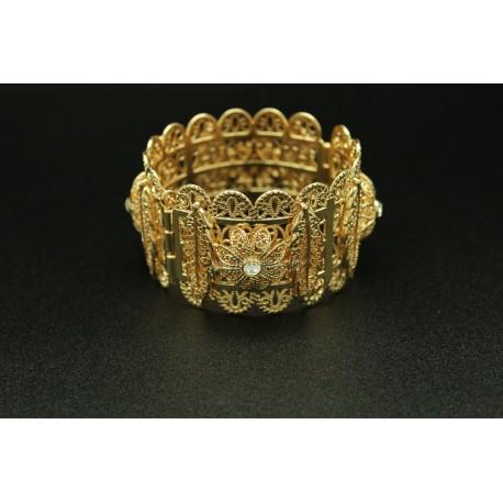 Bracelet en plaqué or tout en virgules et en fleurs