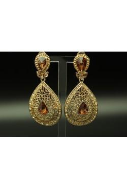 Bijoux boucles d'oreilles plaqué or sertis de pierres