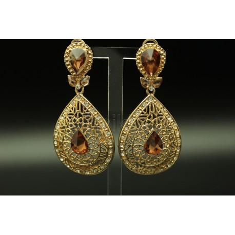 Bijoux boucles d'oreilles orientales en plaqué or parsemé de pierres turquoise